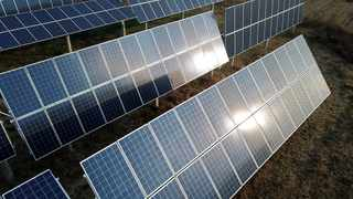 In this Nov. 28, 2019, photo, a solar panel installation is seen in Ruicheng County in central China's Shanxi Province. (AP Photo/Sam McNeil)