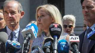 Virginia Roberts Giuffre, centre, says she was trafficked by sex offender Jeffrey Epstein and was made to have sex with Prince Andrew when she was 17. Picture: Bebeto Matthews/AP