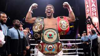 Britain's Anthony Joshua celebrates after beating  Andy Ruiz Jr. on points to win their World Heavyweight Championship contest. Photo: Nick Potts/PA via AP