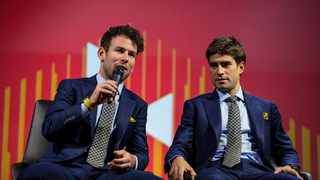 Launching the Bahrain-McLaren cycle team, with Mark Cavendish, left, and Ivan Garcia Cortina, during the press conference at the McLaren Technology Centre in Woking, England, on Monday. Photo: Steven Paston/PA via AP