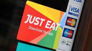 FILE PHOTO: Signage for Just Eat is seen on the window of a restaurant in London, Britain