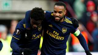 Arsenal came from two goals down to draw 2-2 away to Standard Liege and win their group. Photo: Francois Lenoir/Reuters