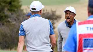 U.S. team player Justin Thomas, left, celebrates with his playing partner and captain, Tiger Woods, on the 18th green in their foursomes match during the President's Cup. Photo: Andy Brownbill/AP Photo