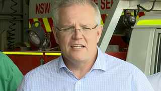 Australia's Prime Minister Scott Morrison speaks to firefighters in Mudgee, New South Wales. Picture: Australian Pool via AP