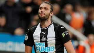 Andy Carroll has beaten the mystery injury that was threatening to end his season — but is now sweating on the resumption of Premier League football and news of Newcastle's takeover with his contract set to expire. Photo: Reuters
