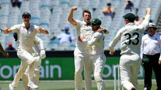 Australia's James Pattinson, centre, celebrates with team-mates after capturing the wicket of New Zealand's Kane Williamson during their cricket test match in Melbourne, Australia on Sunday. Photo: Andy Brownbill/AP