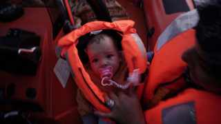 Four-month-old Mira is held by her mother during a rescue by the Ocean Viking humanitarian ship in the Mediterranean Sea. Picture: Renata Brito/AP