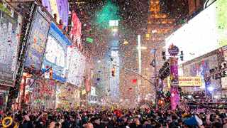 Confetti falls at midnight on the Times Square New Year's Eve celebration in New York. Photo by Ben Hider/Invision/AP