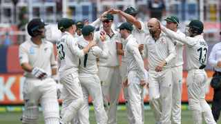 Australian players celebrate the wicket of New Zealand's Colin de Grandhomme, left, during play in their cricket test match in Melbourne, Australia, Sunday, Dec. 29, 2019. Photo: (AP Photo/Andy Brownbill
