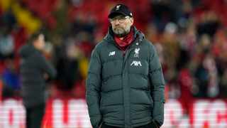 Liverpool's manager Jurgen Klopp looks on during warm up before the English Premier League soccer match between Liverpool and Sheffield United at Anfield Stadium, Liverpool, England, Thursday, Jan. 2, 2020. (AP Photo/Jon Super)