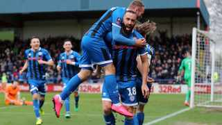 Rochdale's Aaron Wilbraham celebrates scoring his side's first goal during their FA Cup third-round match against Newcastle United at The Crown Oil Arena in Rochdale on Saturday. Photo: Richard Sellers/AP