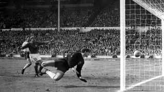 FILE - The July 30, 1966 file photo shows England's controversial third goal scored by Geoff Hurst (not in photo) past German goalkeeper Hans Tilkowski in the World Cup Final at London's Wembley Stadium. Hans Tilkowski, the West Germany goalkeeper in the 1966 World Cup final against England, has died. He was 84. Photo: AP