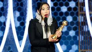 """Awkwafina accepting the award for best actress in a motion picture comedy for her role in """"The Farewell"""" at the 77th Annual Golden Globe Awards at the Beverly Hilton Hotel in Beverly Hills, Calif., on Sunday, Jan. 5, 2020. Picture: AP"""
