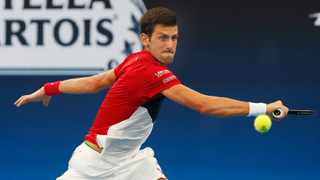 Serbia's Novak Djokovic battled through a stirring challenge from rising Canadian star Denis Shapovalov on Friday to propel his country into the semi-finals of the inaugural ATP Cup team event in Sydney with a 4-6 6-1 7-6(4) victory. Photo: Steve Christo/AP Photo