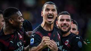 Milan's Zlatan Ibrahimovic celebrates with teammates after scoring his side's second goal during their Italian Serie A match against Cagliari in Cagliari on Saturday. Photo: Spada/AP