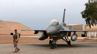 An Iraqi army soldier stands guard near a US-made Iraqi Air Force F-16 fighter jet at the Balad Air Base, Iraq. Iraqi security officials said four members of Iraq's military have been wounded by a rocket attack targeting Balad Air Base, an airbase just north of Baghdad. File picture: Khalid Mohammed/AP