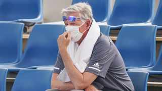"A spectator wears a mask as smoke haze shrouds Melbourne during an Australian Open practice session at Melbourne Park. Smoke haze and poor air quality caused by wildfires temporarily suspended practice sessions for the Australian Open at Melbourne Park on Tuesday, but qualifying began later in the morning in ""very poor"" conditions and amid complaints by at least one player who was forced to forfeit her match. Photo: Michael DodgeAAP Image via AP"