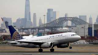 FILE PHOTO: A United Airlines passenger jet takes off with New York City as a backdrop. Picture: Reuters