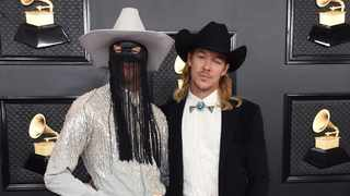 Orville Peck, left, and Diplo arrive at the 62nd annual Grammy Awards at the Staples Center on Sunday, Jan. 26, 2020, in Los Angeles. Picture: Jordan Strauss/Invision/AP