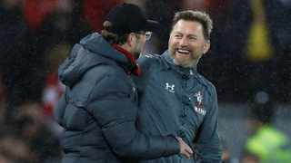FILE - Southampton manager Ralph Hasenhuttl and Liverpool counterpart Jurgen Klopp embrace after their clubs' Premier League clash in February. Photo: Phil Noble/Reuters