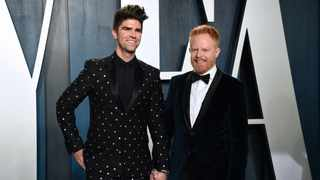 Justin Mikita, left, and Jesse Tyler Ferguson arrive at the Vanity Fair Oscar Party on Sunday, Feb. 9, 2020, in Beverly Hills, Calif. Picture: AP