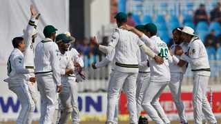 FILE - Pakistan players celebrate a wicket during a Test match against Bangladesh in February. Photo: Anjum Naveed/AP
