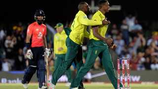 Andile Phehlukwayo, left, gives Lungi Ngidi a hug after after taking a wicket during the T20 cricket match between South Africa and England in East London. Picture: AP