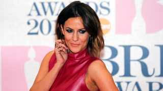 Television presenter Caroline Flack arrives for the BRIT music awards at the O2 Arena in London. Picture: Reuters