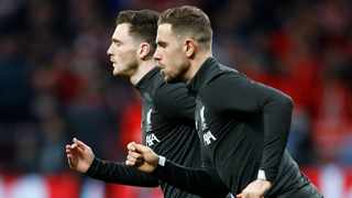Liverpool captain Jordan Henderson and left back Andy Robertson are available for Wednesday's Champions League last-16, second-leg tie against Atletico. Photo: Reuters