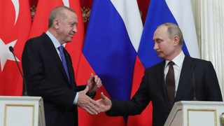 Russia's President Vladimir Putin, right, and Turkish President Recep Tayyip Erdogan shake hands after a joint news conference followed six-hour talks in the Kremlin in Moscow. Picture: Presidential Press Service via AP