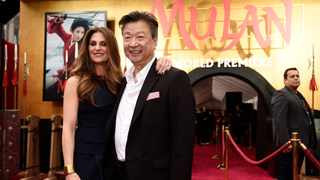 """Niki Caro, left, director of the new live-action """"Mulan"""" poses with cast member Tzi Ma at the premiere of the film at the El Capitan Theatre, Monday, March 9, 2020, in Los Angeles. Picture: AP Photo/Chris Pizzello"""