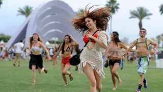 Festivalgoers run toward the main stage at the 2012 Coachella Valley Music and Arts Festival in Indio, California. The Coachella music festival in Southern California has been postponed amid virus concerns. Picture: Chris Pizzello/AP/African News Agency (ANA)