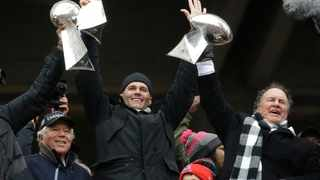 New England Patriots quarterback Tom Brady holds up Super Bowl trophies along with head coach Bill Belichick, right, and team owner Robert Kraft, left, during a rally in Boston to celebrate the win over the Atlanta Falcons in the NFL Super Bowl 51. Brady is now with Tampa Bay. Picture: Elise Amendola/AP