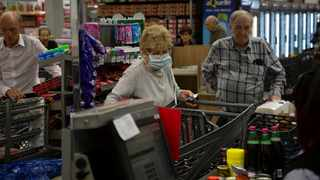Elderly customers line at the checkout point in a Johannesburg supermarket. Picture: Denis Farrell/AP