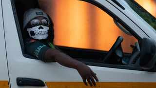 A minibus taxi driver wearing a face musk looks on during his journey in Kwa-Thema east of Johannesburg, South Africa, Tuesday, March 17, 2020. President Cyril Ramaphosa said all schools will be closed for 30 days from Wednesday and he banned all public gatherings of more than 100 people. South Africa will close 35 of its 53 land borders and will intensify screening at its international airports. For most people, the new COVID-19 coronavirus causes only mild or moderate symptoms. For some it can cause more severe illness. (AP Photo/Themba Hadebe)