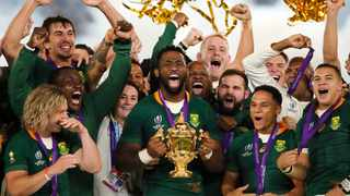 South African captain Siya Kolisi holds the Webb Ellis Cup after South Africa defeated England to win the Rugby World Cup final. Kolisi and other contracted Springboks are likely to take a pay cut because of the Covid-19 pandemic. Picture: Christophe Ena/AP