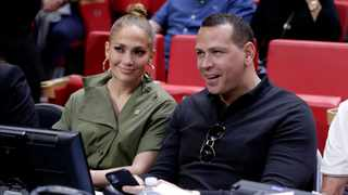 Jennifer Lopez, left, and Alex Rodriguez sit courtside during an NBA basketball game between the Miami Heat and the Los Angeles Lakers in Miami. Picture: AP Photo/Lynne Sladky, File