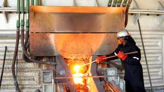 FILE PHOTO: A worker attends to machinery at a smelter at Anglo American Platinum's Unki mine in Shurugwi, Zimbabwe