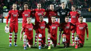 FILE - AZ Alkmaar players pose for a team group photo before their Europa League match against LASK Linsk. Photo: Wolfgang Rattay/Reuters