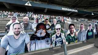 Portraits of spectators have been put in the stands of German Bundesliga soccer club Borussia Moenchengladbach. The Bundesliga's plans to re-start in May are meeting increased opposition, with a German virologist warning that players' safety is at stake. Picture: Martin Meissner/AP