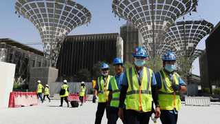 File photo: Technicians walk at the under construction site of the Expo 2020 in Dubai, United Arab Emirates. Picture: AP