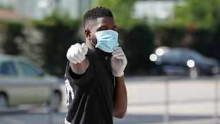 FC Barcelona's Samuel Umtiti wearing a protective face mask and gloves at Ciutat Esportiva Joan Gamper training ground for Covid-19 tests following the outbreak of the coronavirus disease. Photo: Miguel Ruiz/FC Barcelona