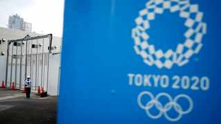 A security guard stands guard at one of the venues for the Tokyo 2020 Olympic Games in Tokyo, Tuesday, May 12, 2020. Photo: AP Photo/Eugene Hoshiko