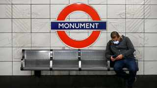 A man wearing a face mask to protect against coronavirus, waits on the platform at Monument underground station, in London. Picture: Alberto Pezzali/AP