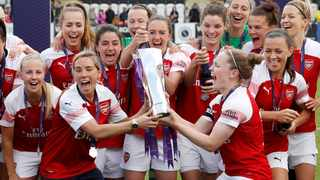 FILE - Arsenal players celebrate after winning the Women's Super League last year. Photo: John Sibley/Reuters