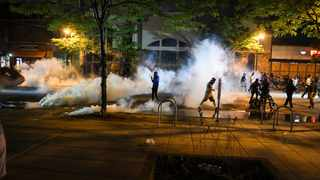 Protesters run from tear gas near the Minneapolis Police third precinct, where they gathered after a white police officer was caught on a bystander's video pressing his knee into the neck of George Floyd, who later died at a hospital, in Minneapolis, Minnesota. Picture: Nicholas Pfosi/Reuters/African News Agency (ANA)