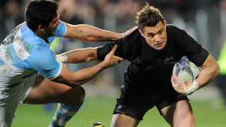 New Zealand All Blacks flyhalf Dan Carter, right, is tackled by Argentina's Jeronimo De la Fuente during a Test match in Christchurch. World Cup-winning All Blacks flyhalf Dan Carter has made a surprise return to Super Rugby in New Zealand at the age of 38. Picture: Ross Setford/SNPA via AP