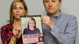 Kate and Gerry McCann pose for the media in 2012 with a missing poster depicting an age progression computer-generated image of their daughter Madeleine at nine years of age, to mark her birthday and the 5th anniversary of her disappearance during a family vacation in southern Portugal. File picture: Sang Tan/AP