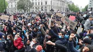 Protesters gather in Parliament Square during the Black Lives Matter protest rally in Whitehall, London, in memory of George Floyd who was killed on May 25 while in police custody in the US city of Minneapolis. Picture: Gareth Fuller/PA via AP