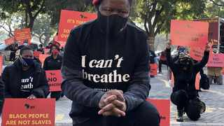 Julius Malema, leader of South Africa's opposition party the Economic Freedom Fighters (EFF), kneels during a protest against the death in Minneapolis police custody of George Floyd